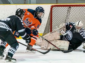 Photo courtesy NOJHL  Soo Thunderbirds forward Caleb Wood (second from left) hunts down a rebound in front of Espanola netminder Owen Willis in NOJHL action at John Rhodes Community Centre