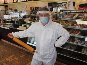 Gus Pantazis, owner of Global Donuts and Deli in Sarnia, is all suited up and ready to safely make paczki Tuesday and Wednesday, for sale at the shop's drive-thru only. Paczki Day has been a tradition at the Sarnia shop for more than three decades.