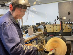 Doug McCuaig is seen here in his shop using a wood lathe to make a wooden bowl. He and his wife Jacqueline recently turned their hobby into a small business called Whimsical What Knots. Submitted photo.