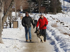 People go for a walk near Bell Park in Sudbury, Ont.
