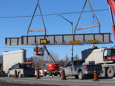 Workers install a section of Vale's railway bridge in Copper Cliff, Ont. on Wednesday February 3, 2021. The city said in a release that work on the bridge will close the southbound lane all day Thursday and the centre lane all day Friday. Motorists can expect delays. John Lappa/Sudbury Star/Postmedia Network