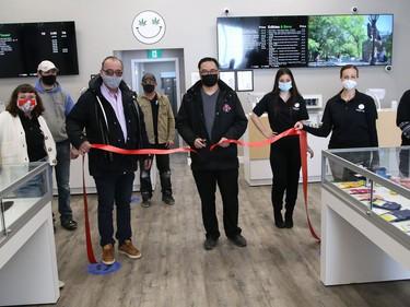 City councillor Bill Leduc and owner John Law cut a ribbon  to officially open Happy Life at 1021 the Kingsway in Sudbury, Ont. on Tuesday February 16, 2021. The business sells wholesale cannabis products. John Lappa/Sudbury Star/Postmedia Network