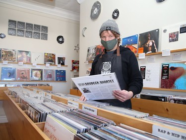 Mark Browning, of Cosmic Dave's Vinyl Emporium on Kathleen Street in Sudbury, Ont., checks over inventory on Wednesday February 17, 2021. The business has reopened after having to close because of the second province-wide lockdown. John Lappa/Sudbury Star/Postmedia Network