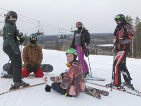This group of friends, from left, Faith Viel, Kyle Spencer, Liam Spencer, Katie Kirkpatrick and Zack Burns were among the first skiers and snowboarders to take in the opening day since lockdown at Mount Jamieson Resort on Friday morning.  RON GRECH/The Daily Press