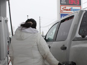 A woman is seen filling up her truck at a gas station on Riverside Drive on Wednesday afternoon. The price of gas, which has been a persistent bane for Timmins motorists, spiked in recent days.  RICHA BHOSALE/The Daily Press