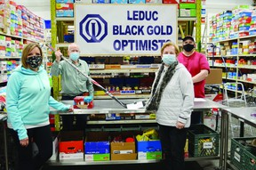 The Leduc Blackgold Optimists Club donated $200 to the Leduc & District Food Bank on Mar. 6 to kick off the Social Distancing Check Challenge. (Lisa Berg)