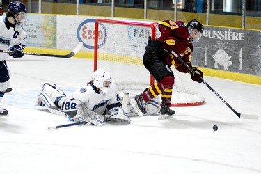 Cochrane Crunch goalie Michael Nickolau makes a sprawling save on a backhand attempt from Timmins Rock captain Derek Seguin during the second period of Sunday afternoon's NOJHL game at the Tim Horton Event Centre in Cochrane. Nickolau made 53 saves to help backstop the Crunch to a 4-2 win over the Rock, helping avenge a pair of setbacks earlier in the weekend. The two teams will faceoff at the McIntyre Arena on Tuesday, at 8:30 p.m. THOMAS PERRY/THE DAILY PRESS