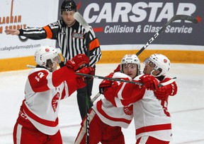 Soo Greyhounds forward Tye Kartye (left) celebrates a goal with teammates Zack Trott and Robert Calisti during 2020 OHL action in Peterborough. Clifford Skarstedt/Peterborough Examiner