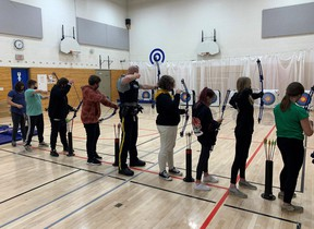 Devon's RCMP detachment commander Sgt. Chris Mosley visited the students at local schools, as well as Riverview Middle School to check out their archery program. (Supplied by Devon RCMP)