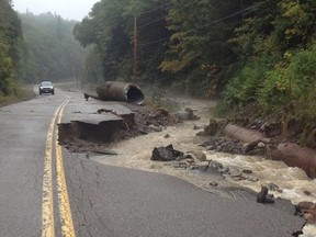 A section of roadway is washed out by the Goulais River after storms in Sault Ste. Marie Ont. early Tuesday morning on Sept 10 , 2013. The Sault Star