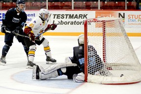 Timmins Rock captain Derek Seguin deposits his NOJHL-leading 23rd goal of the season into the Crunch net behind Cochrane goalie Michael Nickolau during the second period of Tuesday night's NOJHL game at the McIntyre Arena. Seguin, who was playing his final game in a Rock uniform, picked up two points on the night to earn a share of the NOJHL scoring title. The Rock went on to blank the Crunch 3-0. THOMAS PERRY/THE DAILY PRESS
