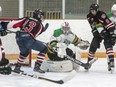 Amherstview Jets goaltender Jacob Evans makes a pad save with Gananoque Islanders Ryan Bigler (13) and Riley Twofoot (6) buzzing around the net in a Provincial Junior Hockey League game in Amherstview on Sept. 15, 2018. The Islanders have folded and are for sale.
