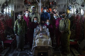 Members of the Canadian Armed Forces' (CAF) Aeromedical Evacuation Flight Unit train with an EpiShuttle during a flight on Nov. 19, 2020, at Canadian Forces Base Trenton in Trenton, Ont. Photo by Pte. Natasha Punt.