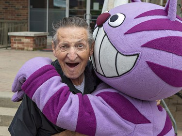 Walter Gretzky gets a hug from Smile City Kitty, the mascot of the Paris Dental Centre on Saturday June 9, 2018 at Find Your Spirit, the tenth anniversary celebration of Harmony Square in downtown Brantford, Ontario. Brian Thompson/Brantford Expositor/Postmedia Network