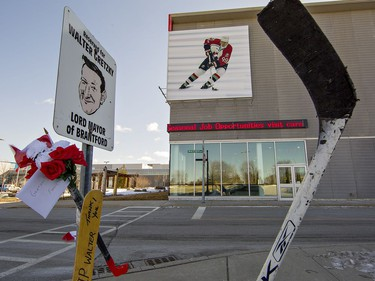 Hockey sticks and floral tributes are placed by Walter Gretzky's reserved parking spot at the Wayne Gretzky Sports Centre in Brantford, Ontario on Friday March 5, 2021. Canada's favourite hockey dad passed away at his Brantford home at the age of 82. Brian Thompson/Brantford Expositor/Postmedia Network