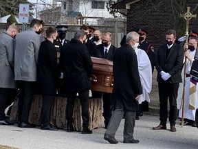 Hockey legend Wayne Gretzky (right) watches as his father Walter's casket is carried from St. Mark's Anglican Church in Brantford during a funeral service on Saturday.