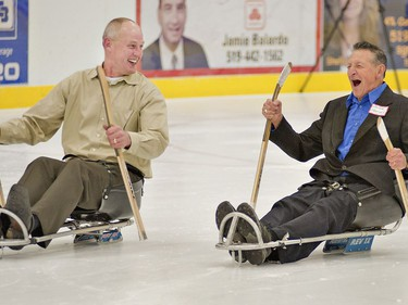 Former NHLer Jay Wells (left) of Paris chuckles with Walter Gretzky as they try out sledge hockey sleds in 2011 at the Brant Sports Complex.