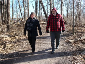 Helma Sterling (left) and her brother Ben Luiking, seen here on March 2, were added to the count of people using the Rotary Eco-Trail by the Eco-Counter system that is providing real-time data on the number of visitors to the popular trail in north Chatham. Ellwood Shreve/Postmedia Network