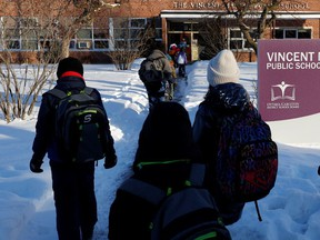 Students walk into Vincent Massey Public School on Smyth Road in Ottawa in mid-February.