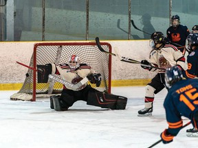 Photo courtesy NOJHL  Soo Thunderbirds defenceman Connor Toms fires a shot at Blind River netminder Gavin Disano, a Sault native, in recent NOJHL action. The teams are slated to meet again on Tuesday at John Rhodes Community Centre.