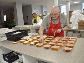 Owen Sound Hunger and Relief Effort board member Pat McDonough prepares lunches along with executive director Colleen Trask Seaman in downtown Owen Sound in this photo from May.