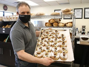 Max Massimiliano, of Regency Bakery in Sudbury, Ont., displays zeppole at the store on Tuesday March 16, 2021. Regency Bakery has partnered with Doyle Dodge and will donate one dollar from every zeppole that is sold between March 13 to March 20, 2021, to St. Joseph's Foundation of Sudbury, in honour of the Feast of St. Joseph that is celebrated on March 19. John Lappa/Sudbury Star/Postmedia Network