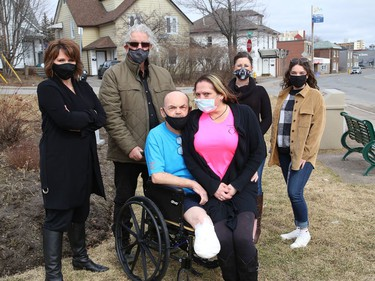 Bob Johnston, who recently had a second leg amputated, is surrounded by supporters Brenda Leroux, left, Rod Dunn, Carrie Wasylyk, Lydia Gaudreau and Chloe Arsenault at the Organ Donor park on Thursday. His friends and supporters are holding a number of fundraising events to help pay for Johnston's wheelchair, prosthesis and modifications that will have to be made to his vehicles.