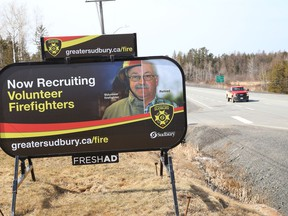 A billboard advertising for volunteer firefighters, sits on the location of  the Beaver Lake Welcome Centre on Tuesday March 30, 2021. John Lappa/Sudbury Star/Postmedia Network