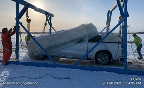 Workers with Big Ice Services lift a truck that had fallen through the Des Rocher River near the Fort Chipewyan Winter Road. Image supplied by Ray Rossington