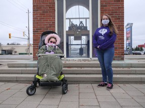 Hollie Hartford, left, and Elizabeth Sinclair-Reece marked Epilepsy Awareness Day last Friday at the Rotary Clock Tower in Tillsonburg. At Sinclair-Reece's request, the clock was lit with purple lights in honour of the day. (Chris Abbott/Norfolk and Tillsonburg News)