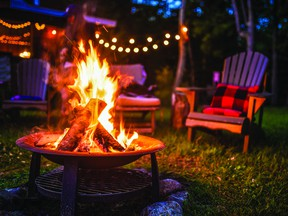 Before cozying up to a backyard fire pit --make sure you know the rules and have an approved pit and permit. File Photo