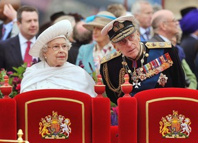 Britain's Queen Elizabeth II, Prince Philip watch the proceedings from the royal barge during the Diamond Jubilee Pageant on the River Thames in London Sunday June 3, 2012. More than 1,000 boats will sail down the River Thames on Sunday in a flotilla tribute to Queen Elizabeth II's 60 years on the throne that organizers are calling the biggest pageant on the river for 350 years. (AP Photo/John Stillwell, Pool)