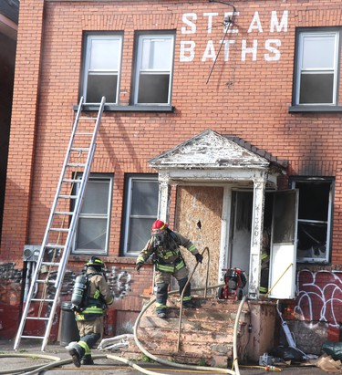 Firefighters respond to a fire at 340 Albert St. W., on Friday, April 16, 2021 in Sault Ste. Marie, Ont. (BRIAN KELLY/THE SAULT STAR/POSTMEDIA NETWORK)