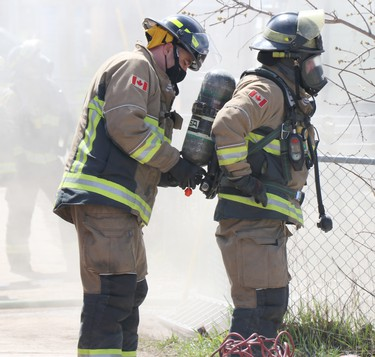 Firefighters battle fire at 93 North St., in Sault Ste. Marie, Ont,. on Saturday, April 17, 2021. (BRIAN KELLY/THE SAULT STAR/POSTMEDIA NETWORK)