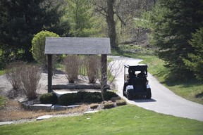 Golf course personnel at The Bridges at Tillsonburg on the course Saturday, April 24, 2021. The course opened despite provincial pandemic restrictions on outdoor recreation, and was fully booked Saturday. (Kathleen Saylors/Woodstock Sentinel-Review)