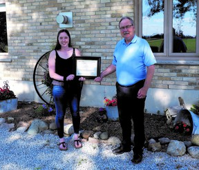 Gracie Goodhill, the 2020 recipient of the Mary Jo Arnold Conservation Scholarship, receives her award from SCRCA chair Joe Faas. The SCRCA is currently accepting applicants for its 2021 scholarships. Handout/Sarnia This Week