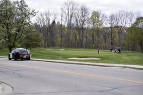 Oxford OPP officers were at The Bridges in Tillsonburg golf course Friday, taking notes and snapping photos of golfers. The golf course was charged Thursday night under the Reopening Ontario Act for violating the province's lockdown orders. (KATHLEEN SAYLORS/Postmedia Network)