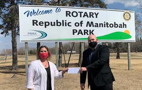 Rotary Club of Portage President Nathan Peto presenting the cheque to PRRA General Manager Angie Shindle. (supplied photo)