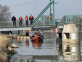 Chatham-Kent fire rescue and Chatham-Kent police officers search Wednesday morning for a man who jumped into the Sydenham River in Wallaceburg while running away from police Tuesday night. A body was found just before noon Wednesday. Photo taken Wednesday, April 7, 2021. (Ellwood Shreve/Chatham Daily News)