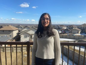 Aarushi Vasal stands on her balcony in Fort McMurray. Image supplied by Raj Vasal