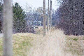 An OPP cruiser sits in the driveway of a home on Duff Line south of Melbourne on Monday April 5, 2021. Duff Line is closed between Cowal Road and Iona Road as police investigate a death. (Derek Ruttan/The London Free Press)