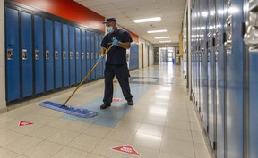 St. Thomas Aquinas custodian Dave Cabral does his rounds on Monday, April 13 at the school, which will remain closed indefinitely as Ontario schools go back online amid rising case counts during the third wave of the COVID-19 pandemic. (Mike Hensen/The London Free Press)