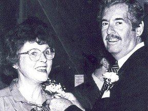 "Former Intelligencer photographer Alicia ""Kenny"" Chambers is honoured at her retirement send-off in 1988 by former publisher Myles Morton. POSTMEDIA"