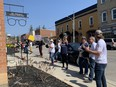 Demonstrators demanding an end to pandemic lockdowns gather Thurday at St. George Family Eyecare Centre, the business office of Brantford-Brant MPP Will Bouma, after a march along St. George's Main Street.
