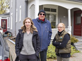Mia Vamos-Yuhasz (left) and her parents Bob Yuhasz and Joanne Vamos were without power and internet for six hours on Thursday April 15, 2021 after a truck brought down a Bell fibre optic cable, causing about $1,000 damage to their Richmond Street home in Brantford, Ontario.