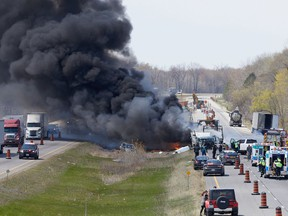 A collision between a tractor trailer and a number of vehicles early Monday afternoon closed the westbound lanes of Highway 403, near Middle Townline Road, in Brant County. OPP said minor injuries were reported. The collision scene is just east of a lane reduction for repairs to a bridge. Photo by Wally Stemberger