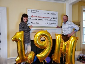 United Way Perth-Huron campaign co-chairs Kathryn and Martin Ritsma help mark the agency's fundraising success in surpassing its 2020/21 goal. Submitted