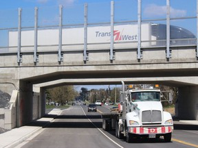 An eastbound transport on Highway 401 and southbound transport on Pitt Street on Friday afternoon. Photo on Friday, April 23, 2021, in Cornwall, Ont. Todd Hambleton/Cornwall Standard-Freeholder/Postmedia Network