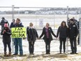 Supporters gather outside GraceLife Church near Edmonton April 11 to protest being barred from in-church services. The church was fenced off by police and Alberta Health Services for violating COVID-19 rules.