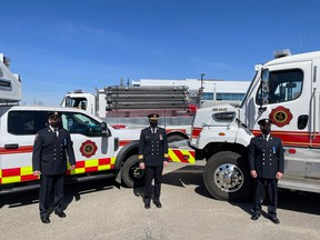 First Class Firefighters Dale Krawec (left) and Robert Beer (right) are celebrated on April 14 by colleagues including Fire Chief Shawn Polley (center) for their time with Cochrane Fire. Town of Cochrane